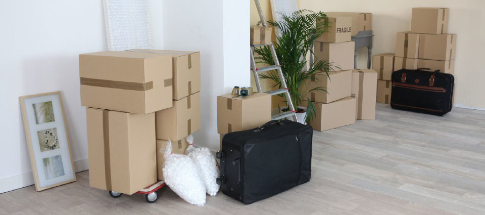 Pile of boxes and suitcases prepared by professional movers
