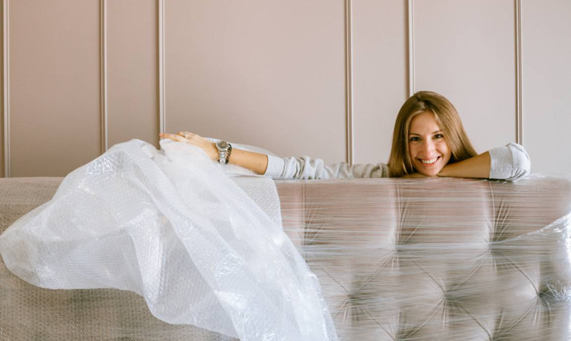 A woman smiling behind the packed headboard.